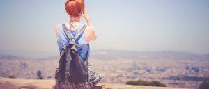 girl overlooking city view
